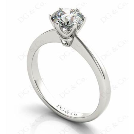 Platinum Brilliant Cut Six Claw Set Diamond Ring On A Upswept Reverse Taper Band.