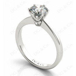 Platinum Brilliant Cut Six Claw Set Diamond Ring On A Upswept Reverse Taper Band.