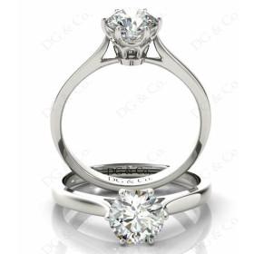 Brilliant Cut Six Claw Set Diamond Ring on a Plain Band.