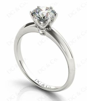 Platinum Brilliant Cut Six Claw Set Diamond Ring On A Plain Band.