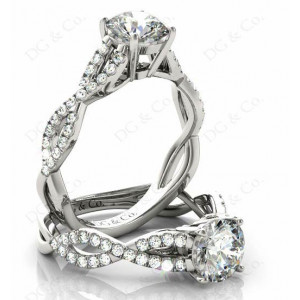 Brilliant Cut Four Claw Set Diamond Ring with Pave Set Stones Down the Shoulders