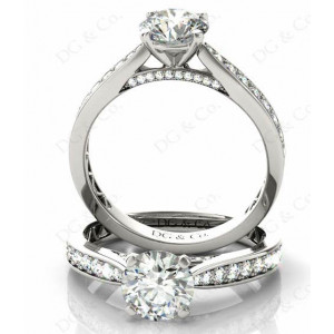 Brilliant Cut Four Claw Set Diamond Ring with Pave Set Stones Down the Shoulders and on Both Sides.