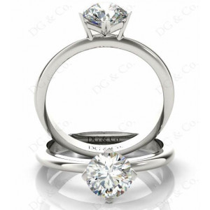 Brilliant Cut Four Claw Set Diamond Ring with Plain Band.