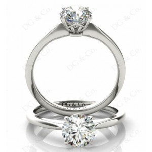Brilliant Cut Four Claw Set Diamond Ring With a Plain Band.