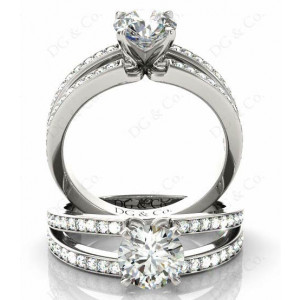 Brilliant cut diamond ring with four claws set centre stone