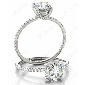 Brilliant Cut Cross Over ring claw set diamond with pave set side stone