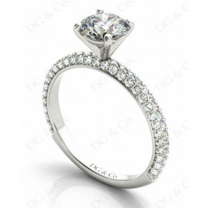 Brilliant Cut claw set diamond ring with micro pave set side stone