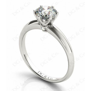 Platinum Brilliant Cut Six Claw Set Diamond Ring On A Plain Band.