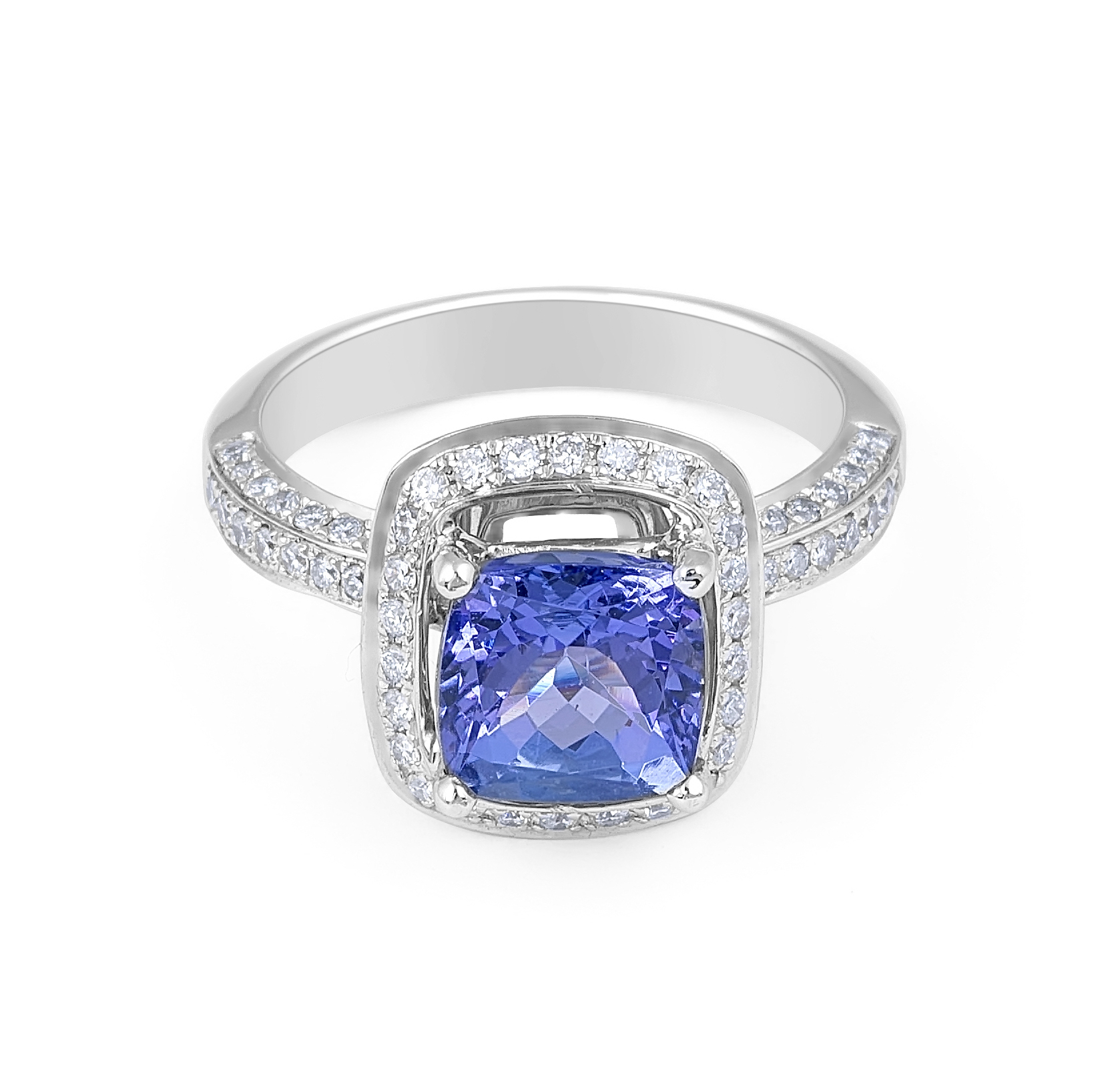 Vintage Style Tanzanite Halo Diamond Ring in 18 Karat White Gold